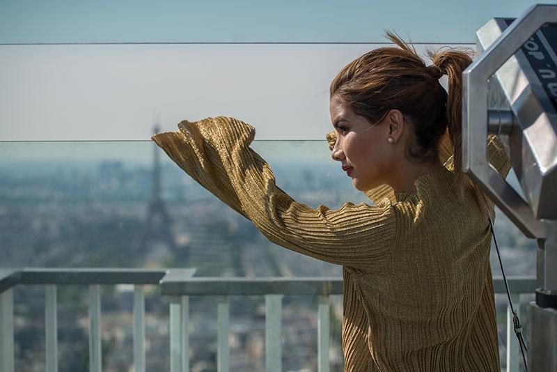 Girl looking paris view from Montparnasse