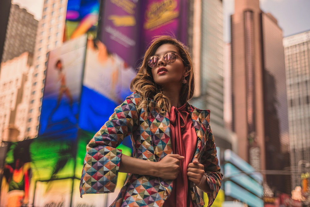 New Yorck City Travel Photo of a girl in Time Square with billboards on the background