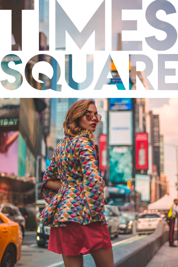 Girl wearing a colorful jacket and sunglasses with time square billboards on the brackground