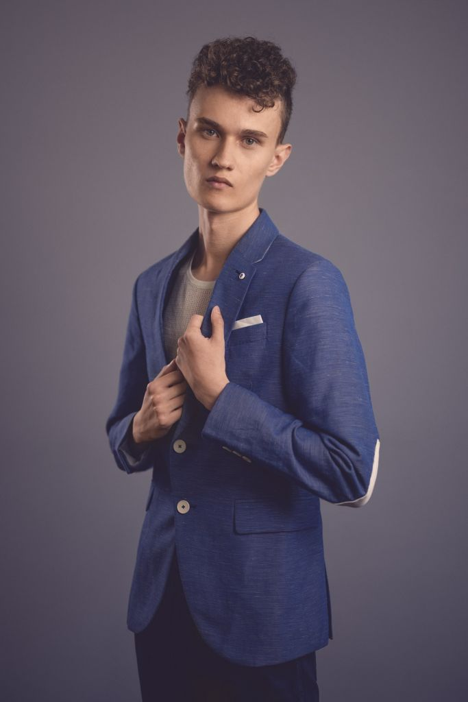 Male model with curly hair test shoot studio photography wearing a blue blazer
