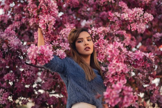 Portrait photography of girl with a pink cherry blossom tree