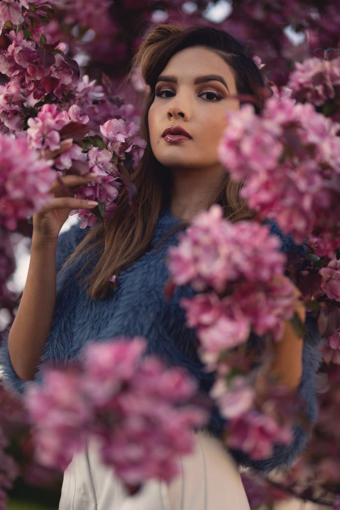 Portrait photography of girl with a pink cherry blossom tree during the Spring