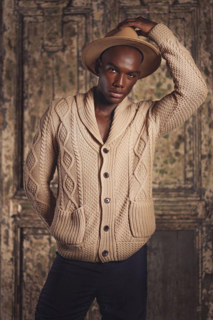 black male model photography portrait wearing knit sweater and felt hat
