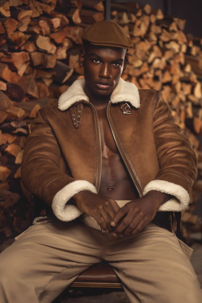 black male model photography portrait in the woods wearing leather jacket