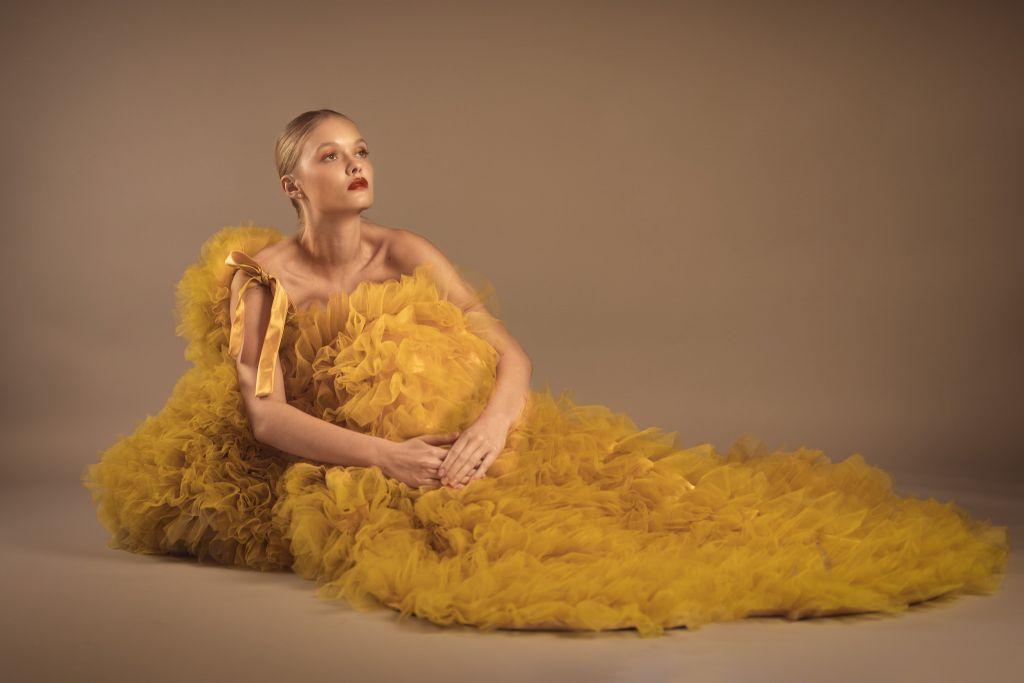 Fashion Editorial Model Alessiya Merzlova - Photo of girl wearing a yellow tulle dress posing on the floor