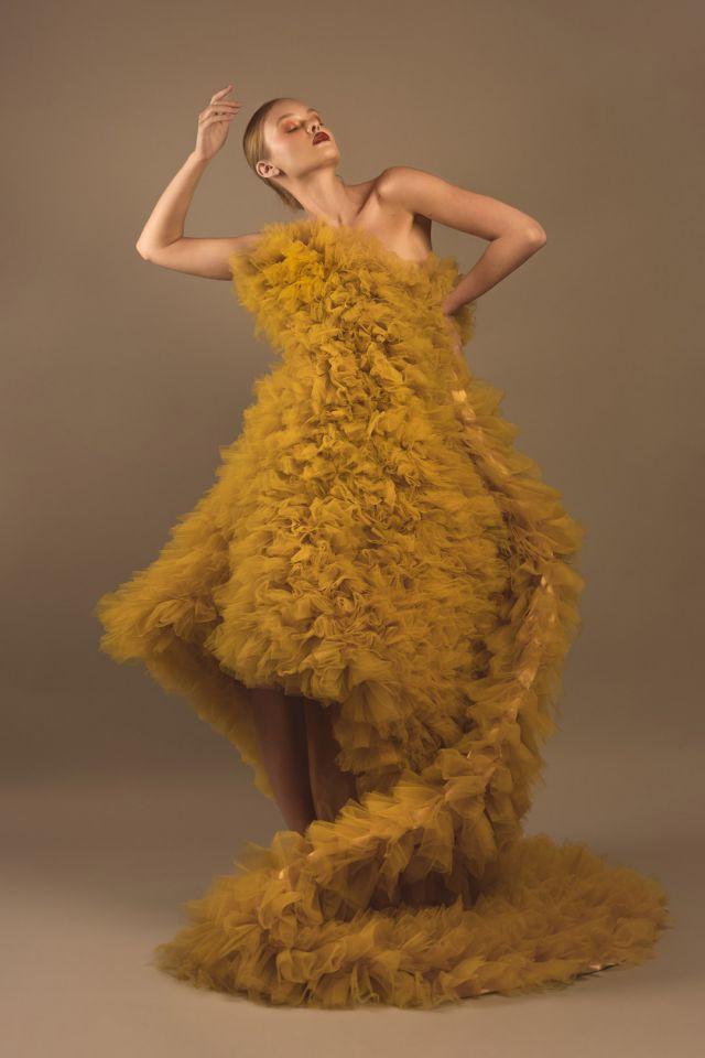Fashion Editorial Model Alessiya Merzlova - Portrait photo of girl wearing a yellow tulle dress posing as a dancer