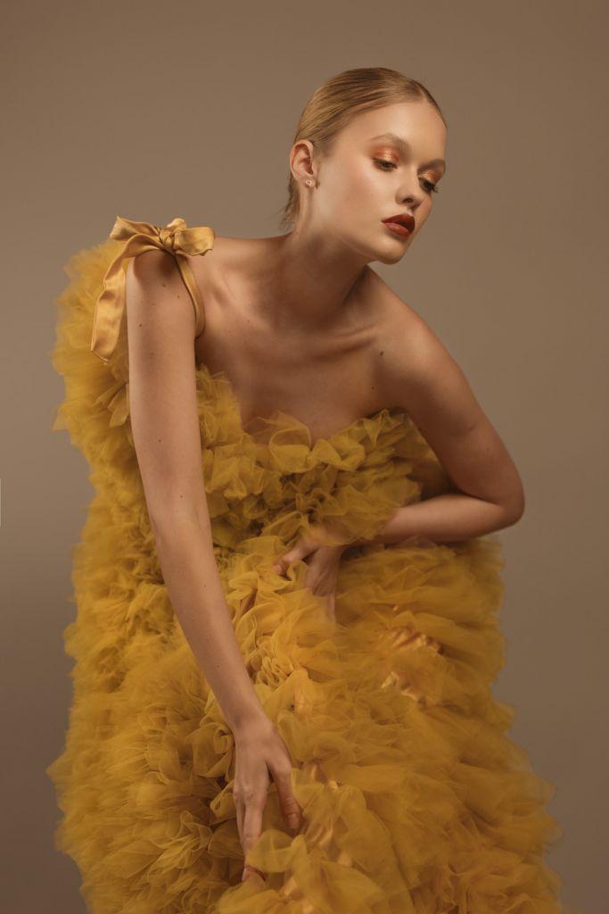 Fashion Editorial Model Alessiya Merzlova - Photo of girl wearing a yellow tulle dress