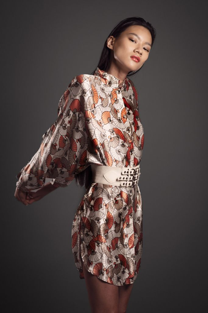 Fashion Editorial Asian Model wearing a silk short dress with print and a big belt