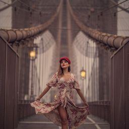 Photo of woman standing on the Brooklyn Bridge - New York City